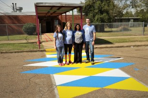 The Carl Small Town Center team celebrates with Aberdeen Elementary principal Kristen Fondren following the completion of the crosswalk.