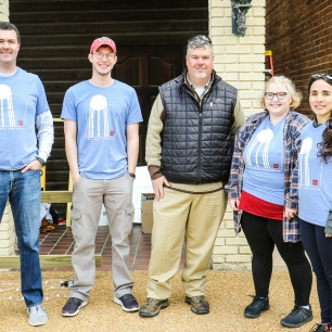 Ripley Mayor Chris Marsalis (center) works with CREATE students and instructors to make improvements to a downtown alley in Ripley.