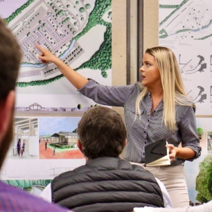 An MSU architecture student presenters her ideas for Ripley's First Monday Trade Days site.
