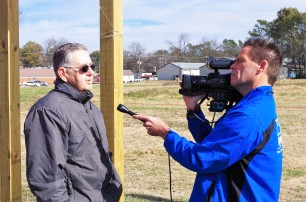 A local resident is interviewed by a local news channel during the CIRD workshop.