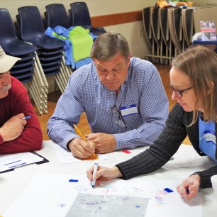 Local residents discuss bike and pedestrian improvements with a CIRD transportation expert.